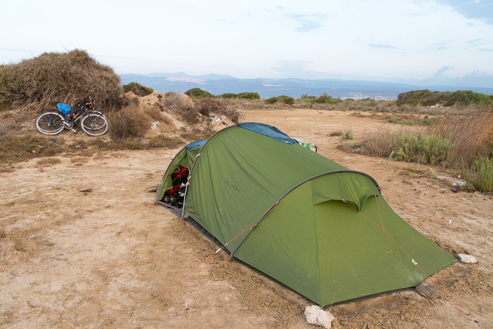 Camping on sand dunes may seem idyllic. However, we were attacked by sand flies and we soon found out that the bush we'd used to prop our bikes on was used by the beach-goers as a lavatory.