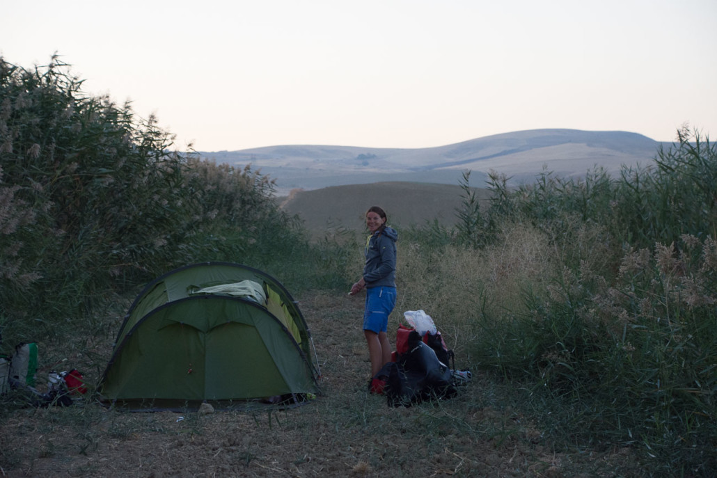 With 115km on the clock, we pitched our tent behind some reeds that shielded us from the road.