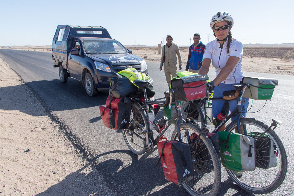 Our police kept a close eye on us as we changed a puncture - but gave up once we'd passed through Qena