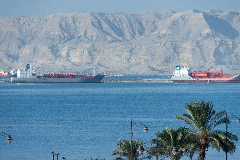 Ships lining up to enter the Suez Canal