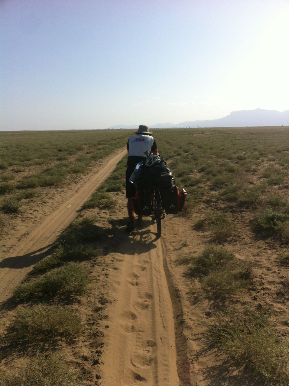 Hauling our bikes through the sand in the no-mans-land between Ethiopia, South Sudan and Kenya
