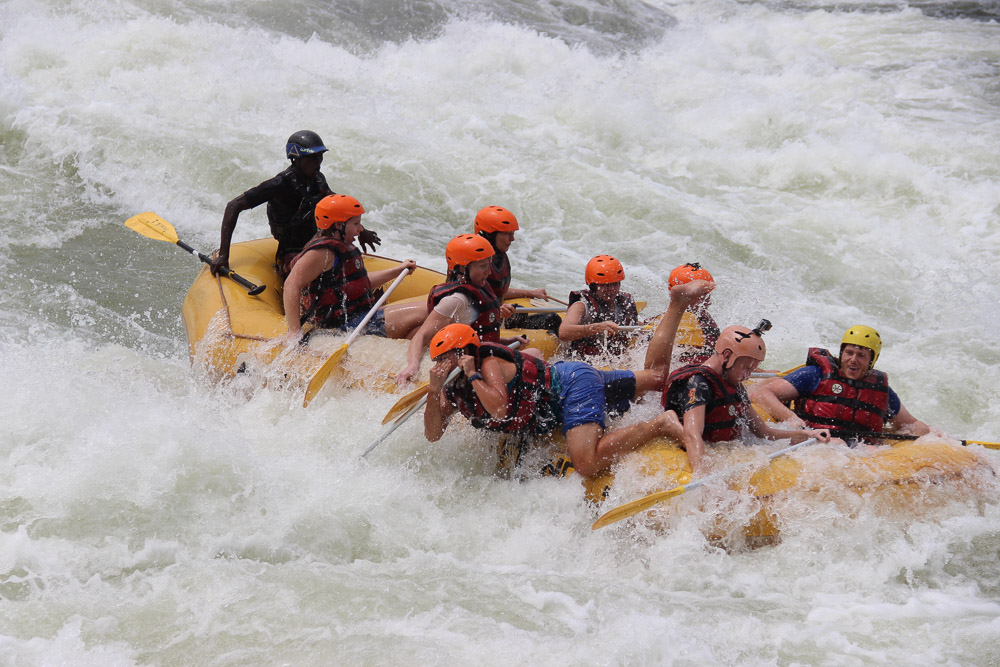 Emily (in the blue shorts) manages to hold her nose as she takes another tumble form the raft